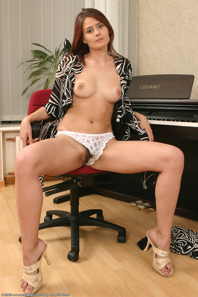 Nude girl under overalls